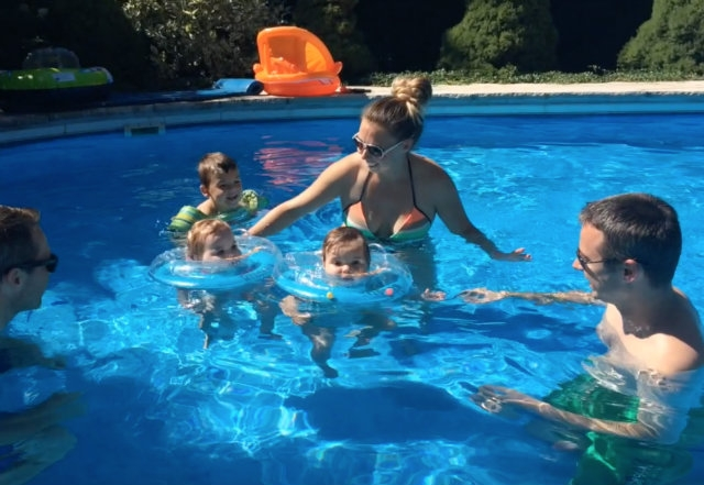 Twins trying infant neck floats